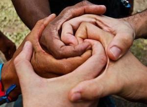 multi-ethnic clasped hands